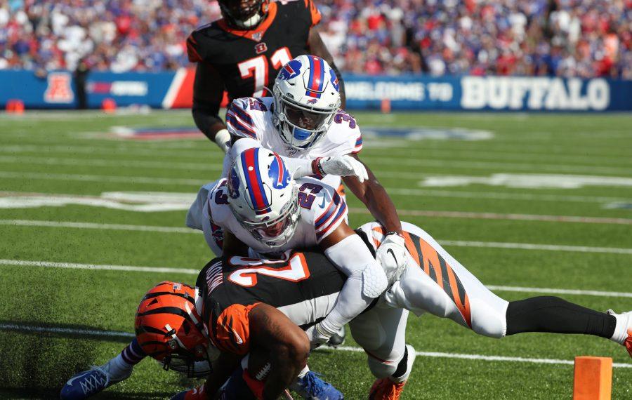 Bills safety Micah Hyde tackles Bengals running back Joe Mixon in Week 3. (James P. McCoy/Buffalo News)