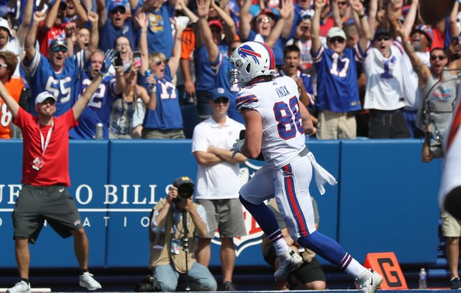 Dawson Knox rushes for a touchdown in the first quarter at New Era Field against the Bengals. (James P. McCoy/Buffalo News)
