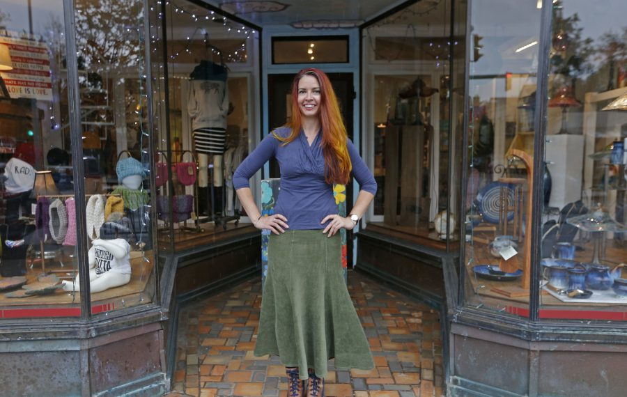 Therese Deutschlander wears a favorite outfit that coordinates with her newly colored hair in autumnal hues. (Robert Kirkham/Buffalo News)