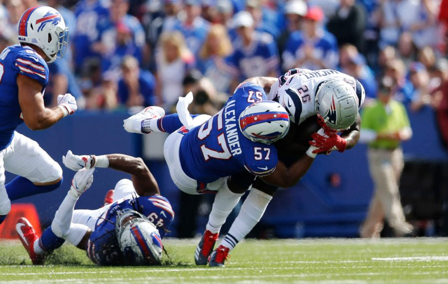 Bills outside linebacker Lorenzo Alexander tackles New England running back Sony Michel. (Derek Gee/Buffalo News)