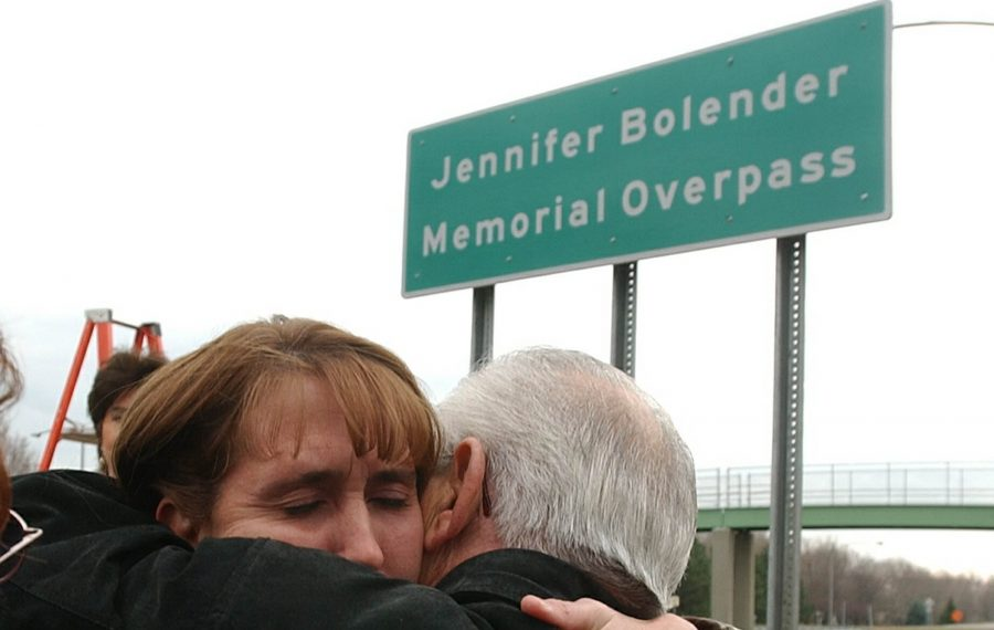Jennifer Bolender's mother, then Tina Balsano, hugs her father-in-law, Frank Balsano, on Tuesday, Nov. 18, 2003, after a pedestrian overpass on the LaSalle Expressway was named in honor of her daughter. (Harry Scull Jr./News file photo)