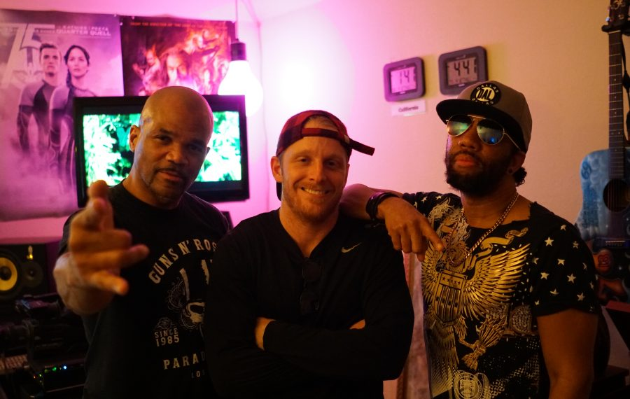 """Buffalo Bills wide receiver Cole Beasley (center) and hip hop icon Darryl McDaniels (left), better known as DMC of the group Run-DMC, recorded a song called """"Adrenaline Junkie,"""" which was produced by Victor """"Phazz"""" Clark (right)."""