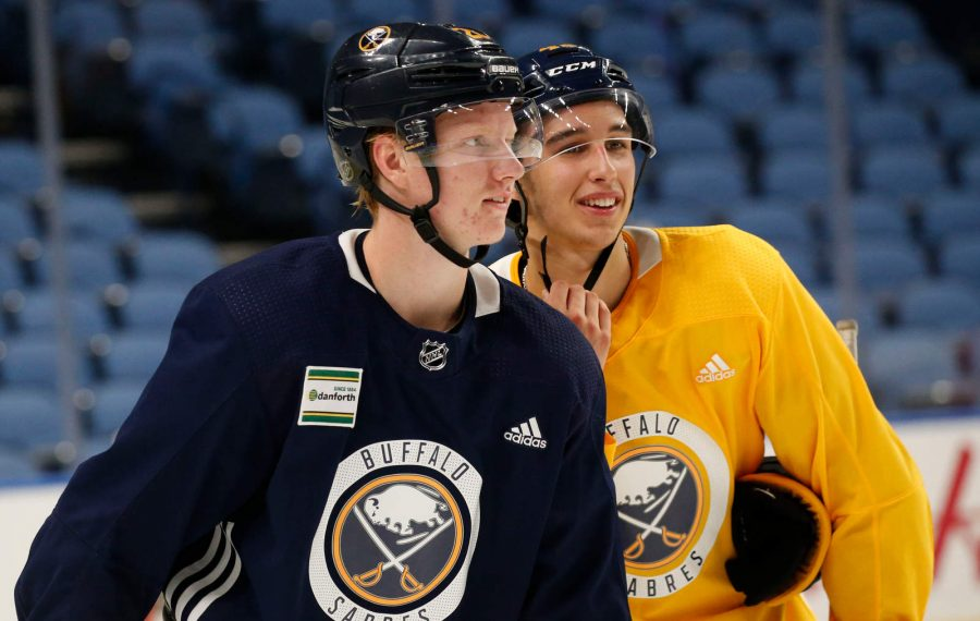Rasmus Dahlin, left, and Dylan Cozens get set for a drill Thursday in KeyBank Center. (Derek Gee/Buffalo News)