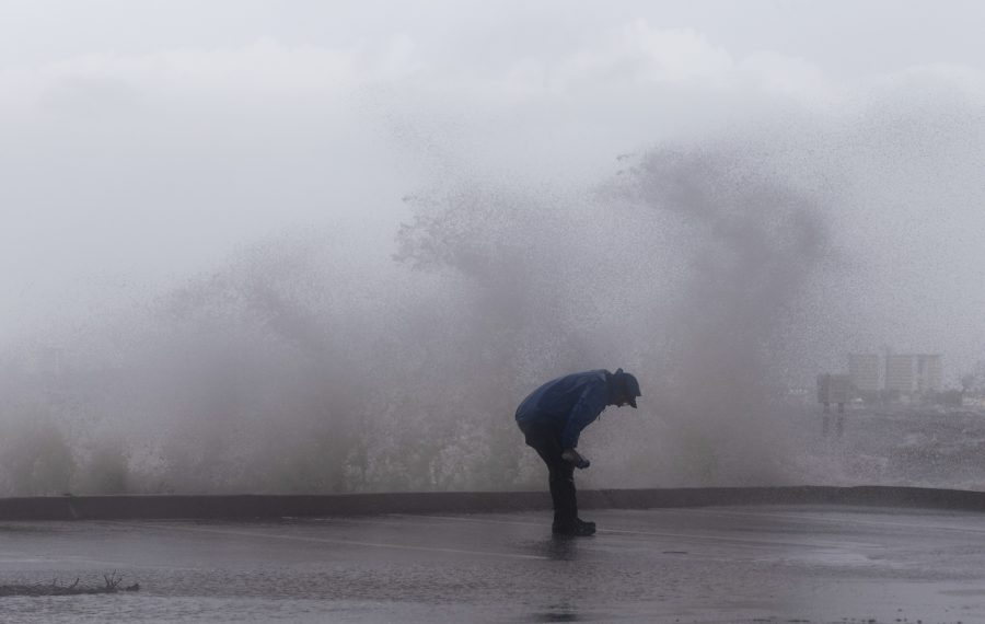 A reporter is splashed by waves as strong gusts of wind and bands of heavy rain hit the Jensen Beach Causeway Park in Jensen Beach, Fla., on Sept 3, 2019. Weakening slightly but still packing a powerful punch, Hurricane Dorian churned towards the southeastern coast of the United States after delivering a devastating blow to the Bahamas. (Adam DelGiudice/AFP/Getty Images)