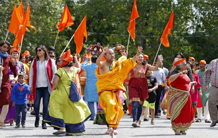 """As part of their Ganesh Festival, the Hindu Cultural Society had a procession to the water Sunday for an """"immersion ceremony"""" at Amherst Veterans Canal Park in Amherst. (Robert Kirkham/Buffalo News)"""