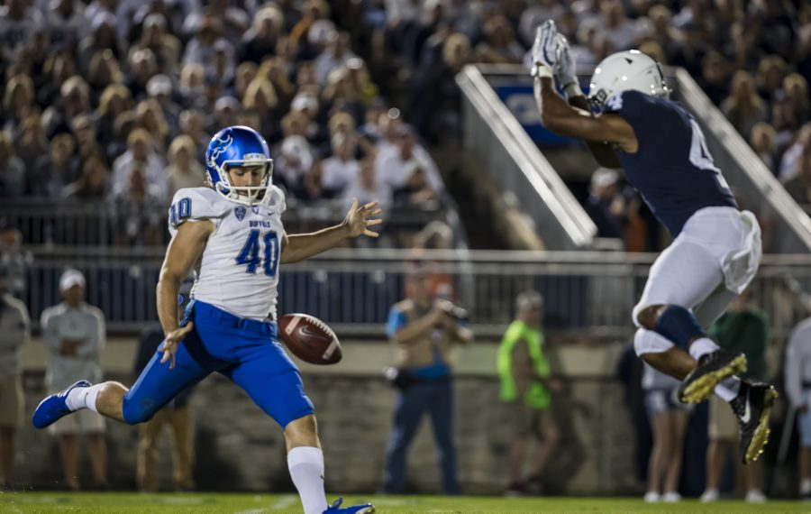 Journey Brown of the Penn State Nittany Lions partially blocks a punt by Evan Finegan of the Buffalo Bulls during the second half at Beaver Stadium on Sept. 7, 2019. (Getty Images)