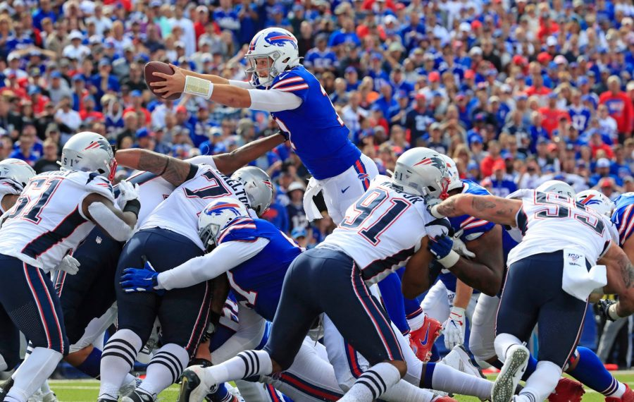Bills quarterback Josh Allen scores against the Patriots in the third quarter. (Harry Scull Jr./Buffalo News)