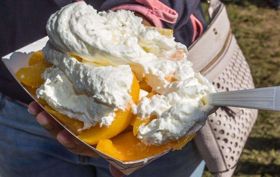 Fresh peaches and whipped cream from the Niagara County Peach Festival, which opens Thursday. (Don Nieman/Special to The News)