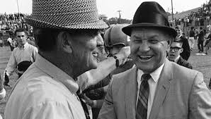"Alabama coach Paul ""Bear"" Bryant, right, meets Mississippi coach John Vaught on the field prior to a game in 1970."