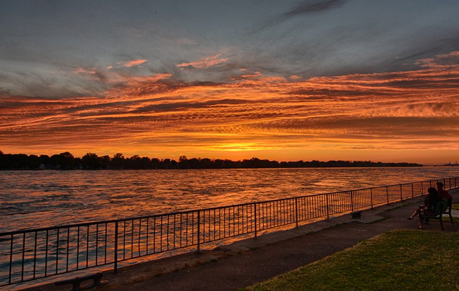 Whether you venture out onto the breakwater or settle into a riverside bench, Broderick Park offers panoramic sunset view...sometimes featuring a mood cloud or two. (Matt Weinberg)