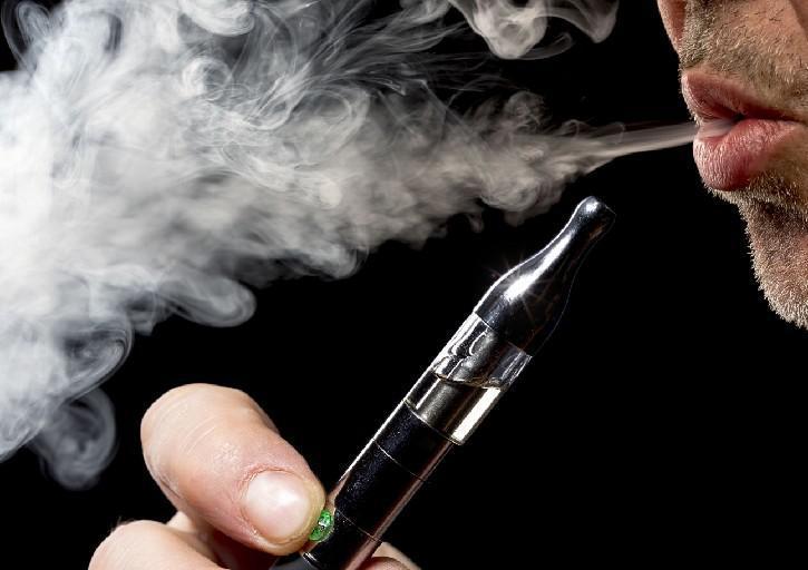 Man smoking an e-cigarette. (News file photo)