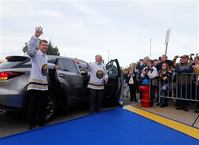 Fans and Sabres alumni enjoy the party in the plaza Saturday, Oct. 5, 2019, before the season opener against the New Jersey Devils in the team's 50th anniversary season.