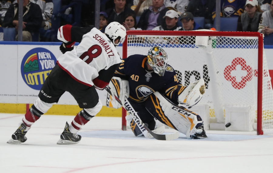 Buffalo Sabres goaltender Carter Hutton (40) gives up the game wining goal in overtime to Arizona Coyotes center Nick Schmaltz (8) at Key Bank Center in Buffalo, NY on Monday, Oct. 28, 2019.  James P. McCoy/Buffalo News