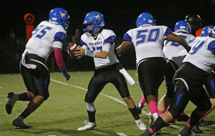 Kenmore West quarterback QB Zach Boyes drops back to hand off against McKinley. (Robert Kirkham/Buffalo News)