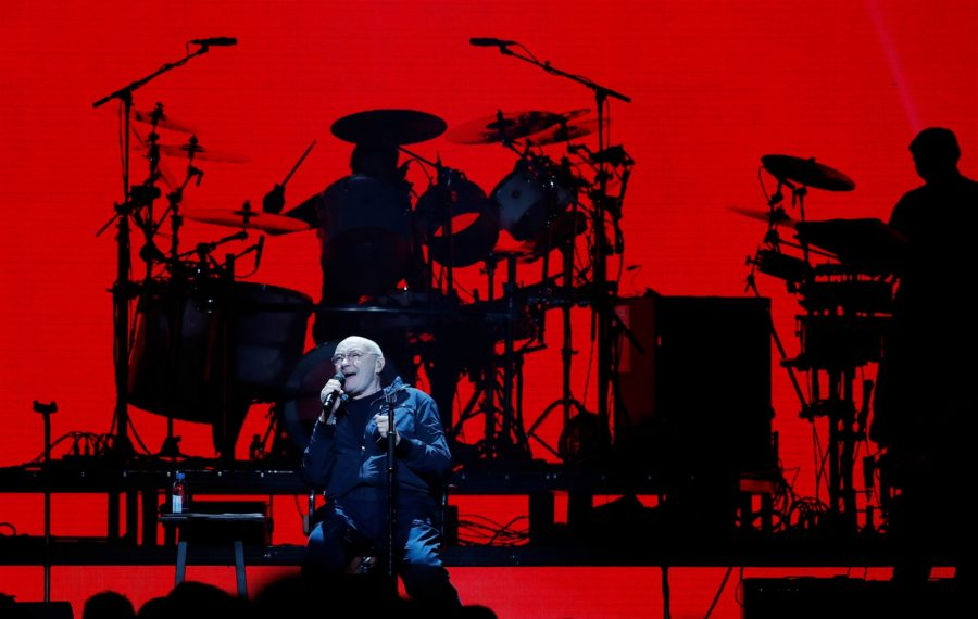 Phil Collins performs while sitting in a chair in KeyBank Center on Friday, Oct. 4, 2019. (Sharon Cantillon/Buffalo News)