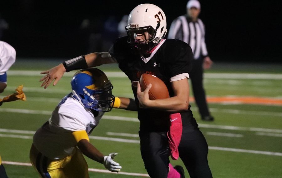Wilson's Drew Westmorland beats Cleveland Hill's Chris Diem for a first down in the second quarter at Wilson high school on Friday, Oct. 4.  (James P. McCoy/Buffalo News)