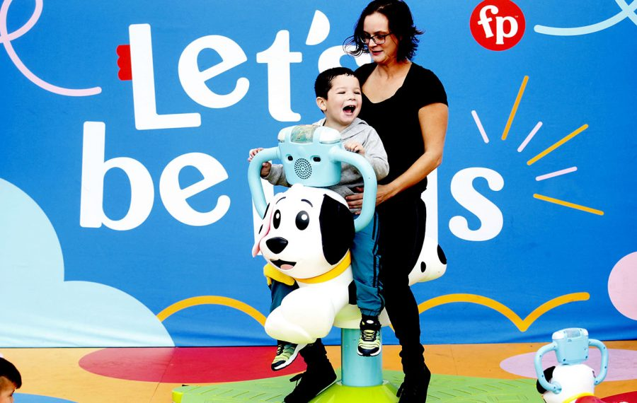 "Vivian Maloney gives her son Cameron, 4, a ride on bouncy character at the Fisher-Price ""Let's Be Kids"" pop-up nationwide tour in the Walmart parking lot on Transit Road in Depew on Sunday, Oct. 6, 2019.  (Robert Kirkham/Buffalo News)"