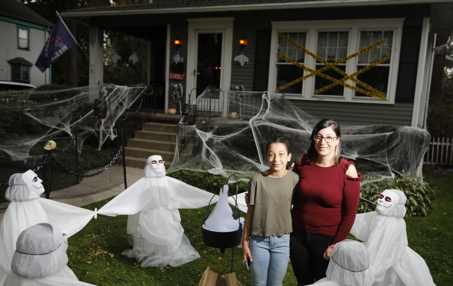 Samantha Muscato and her daughter Kira Meadows, 12, stand amid the Halloween decorations outside their City of Tonawanda home.  (Derek Gee/Buffalo News)