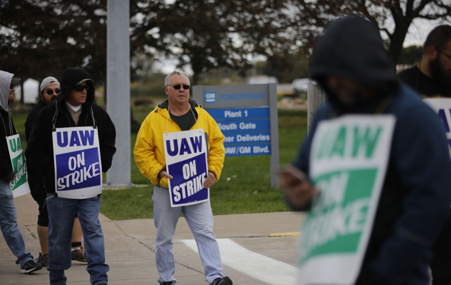 Striking UAW members picket in front of GM's Tonawanda plant on Monday. A tentative contract may soon end the strike. (Derek Gee/Buffalo News)