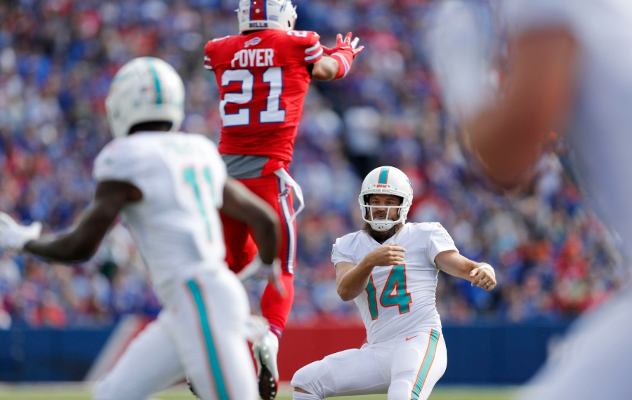 Dolphins quarterback Ryan Fitzpatrick throws past a leaping Bills free safety Jordan Poyer in the first quarter. (Mark Mulville/Buffalo News)