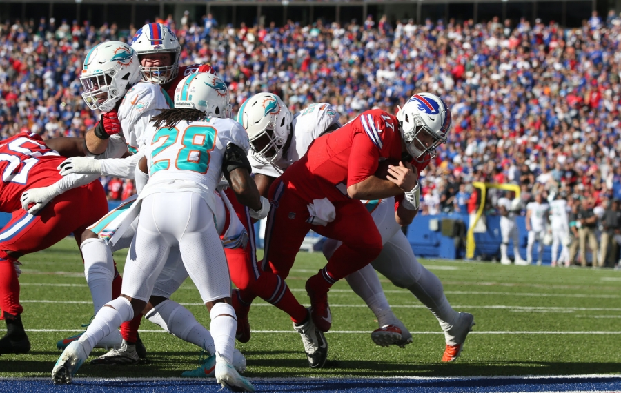 Bills quarterback Josh Allen scores the two-point conversion in the fourth quarter. (James P. McCoy/Buffalo News)