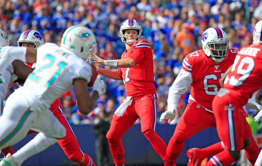 Josh Allen throws against the Miami Dolphins. (Harry Scull Jr./Buffalo News)