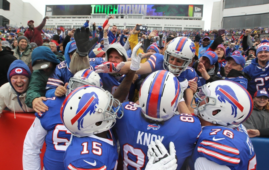 Bills wide receiver Cole Beasley celebrates with the fans and his teammates after scoring against Philadelphia. (James P. McCoy/Buffalo News)