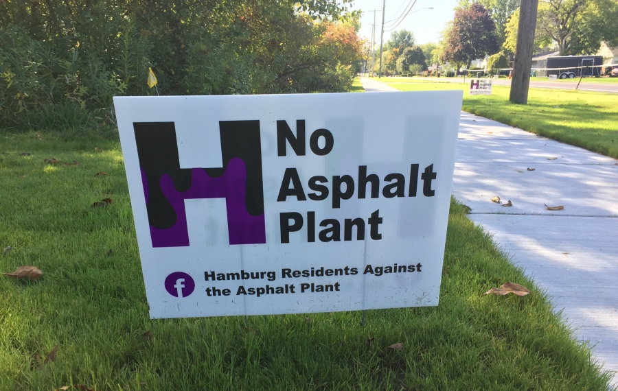 Signs dot lawns in Hamburg opposing a proposed asphalt plant. (Barbara O'Brien/Buffalo News)