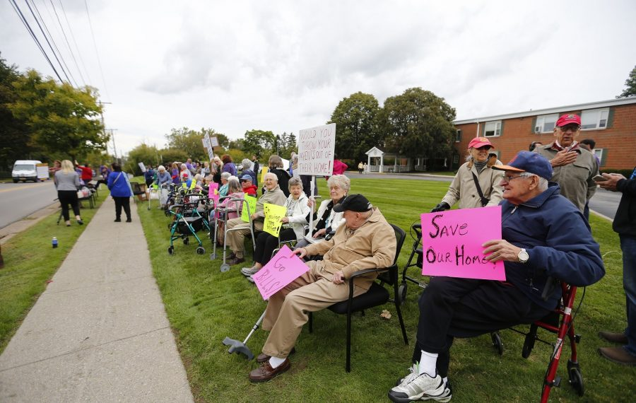 Residents and staff protest Monday outside of Blocher Homes on Evans Street in Williamsville. (Mark Mulville/Buffalo News)