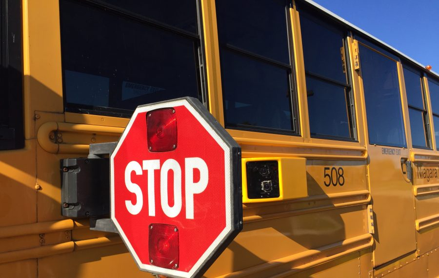 Cameras are placed behind the stop signs on two buses in the Niagara Falls School District in a pilot program. (Barbara O'Brien/Buffalo News)