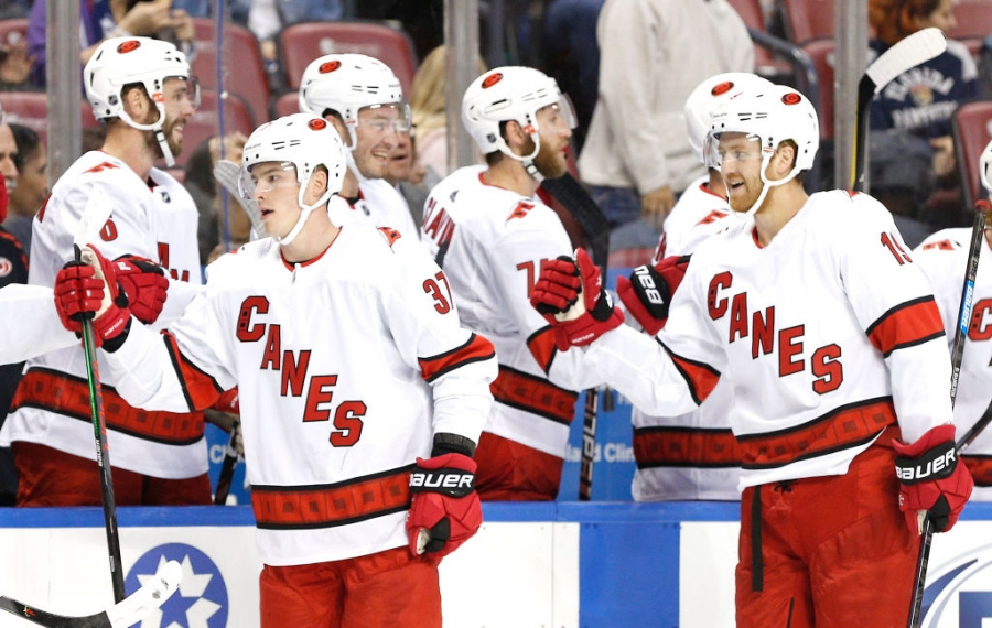Wearing their new road jerseys, Andrei Svechnikov (37) and Dougie Hamilton (19) celebrate a goal during the Hurricanes' 6-3 win Tuesday at Florida (Getty Images).