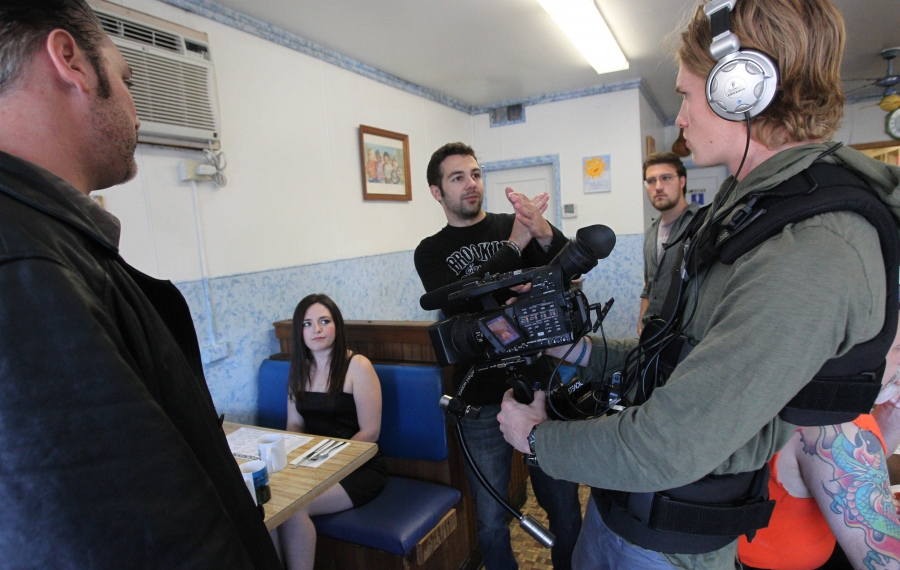 """In this 2013 photo, filmmaker Ken Cosentino, center, directs cameraman Billy Fortier, right, and actors Bill Kennedy, now a Niagara Falls councilman, and Madison Ranne during shooting of his zombie movie """"Within"""" at the Sunshine Café in Niagara Falls. (Sharon Cantillon/News file photo)"""