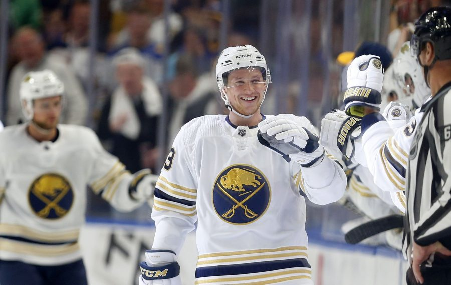 Jeff Skinner is congratulated by teammates after scoring goal for the Buffalo Sabres on Saturday night in KeyBank Center. (Mark Mulville/The Buffalo News)