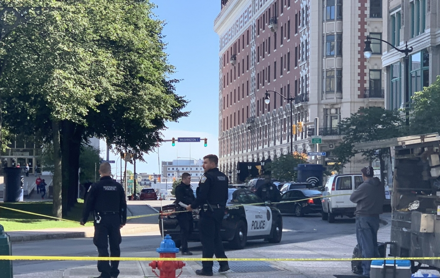 Police cordoned off an area at Main and Court streets after a stabbing. (Maki Becker/Buffalo News)