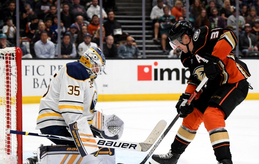 ANAHEIM, CALIFORNIA - OCTOBER 16:  Linus Ullmark #35 of the Buffalo Sabres stops Jakob Silfverberg #33 of the Anaheim Ducks during the third period in a 5-2 Ducks win at Honda Center on October 16, 2019 in Anaheim, California. (Photo by Harry How/Getty Images)