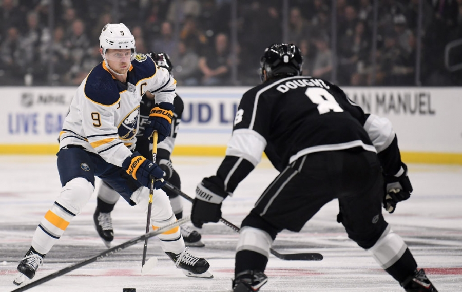 Buffalo Sabres center Jack Eichel skates in on Drew Doughty during the first period Thursday. (Getty Images)