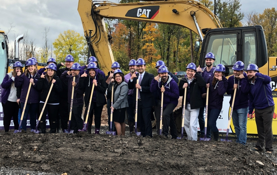 Hover Networks employees and town officials break ground on the information technology company's new Amherst headquarters on Wednesday. (Amherst Chamber of Commerce)