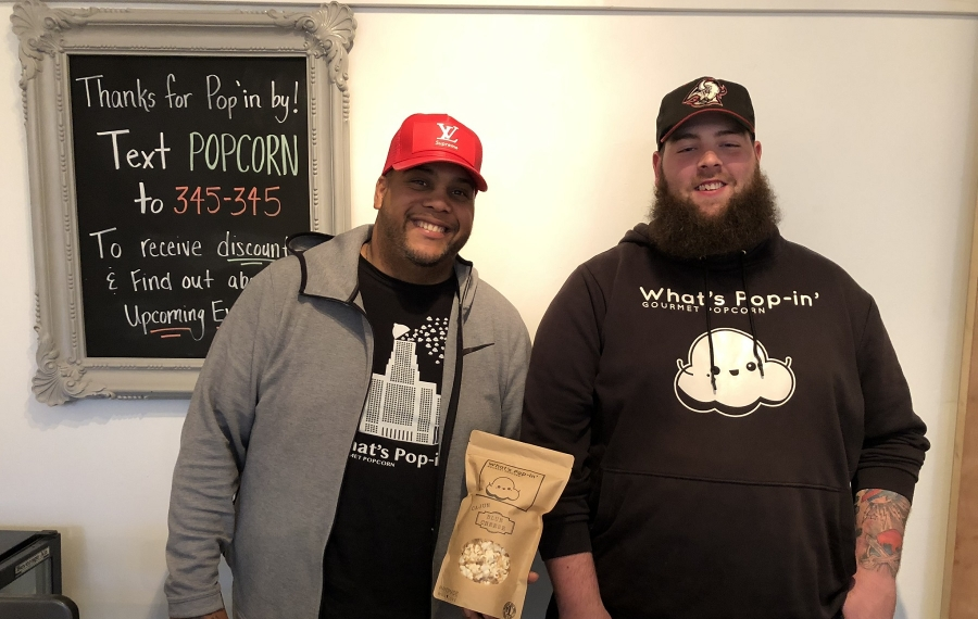 Stefan Coker, left, and Dave Whelan are the two co-founders of What's Pop-in' Gourmet Popcorn. (Ben Tsujimoto/Buffalo News)