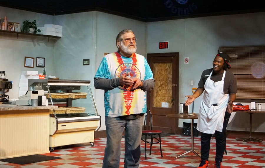 """The infectious energy brought into the doughnut shop by Franco (played by Jake Hayes, right) can't be denied by his new boss  (played by Steve Jakiel) in """"Superior Donuts."""" It is presented by Road Less Traveled Productions at Shea's 710 Theatre. (Photo courtesy of Gina Gandolfo)"""