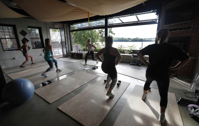Owner Bobbi Stokes leads a circuit training class at Riverview Fitness in Youngstown, which offers a great view of the Niagara River. (Sharon Cantillon/Buffalo News)