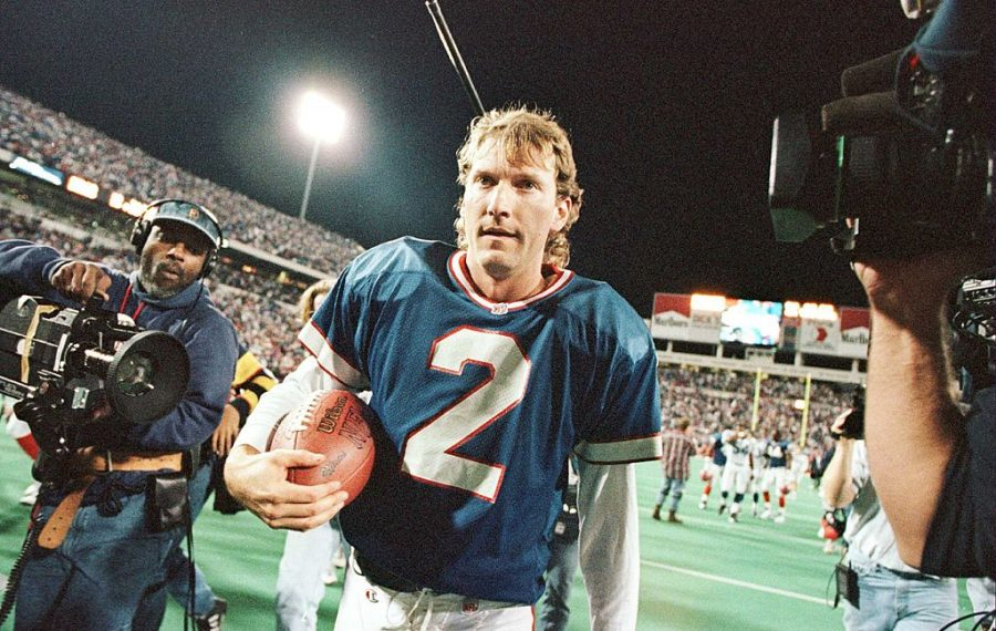 Former Bills kicker Steve Christie walks off the field with the ball he kicked through uprights with 5:38 left in a 1996 overtime against the Indianapolis Colts to win the game 16-13 at Rich Stadium. (Getty Images)