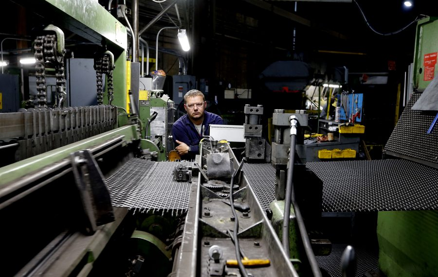 Metal weaver Scott Nowak monitors the process on one of the machines at Buffalo Wire Works. (Robert Kirkham/Buffalo News)