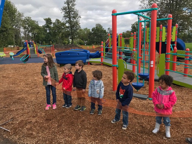 """Children get ready for a """"ribbon cutting"""" before being freed to play on the new playground at MLK Park. The $300,000 playground was funded by the Ralph C. Wilson Jr. Foundation and Blue Cross Blue Shield's Blue Fund."""