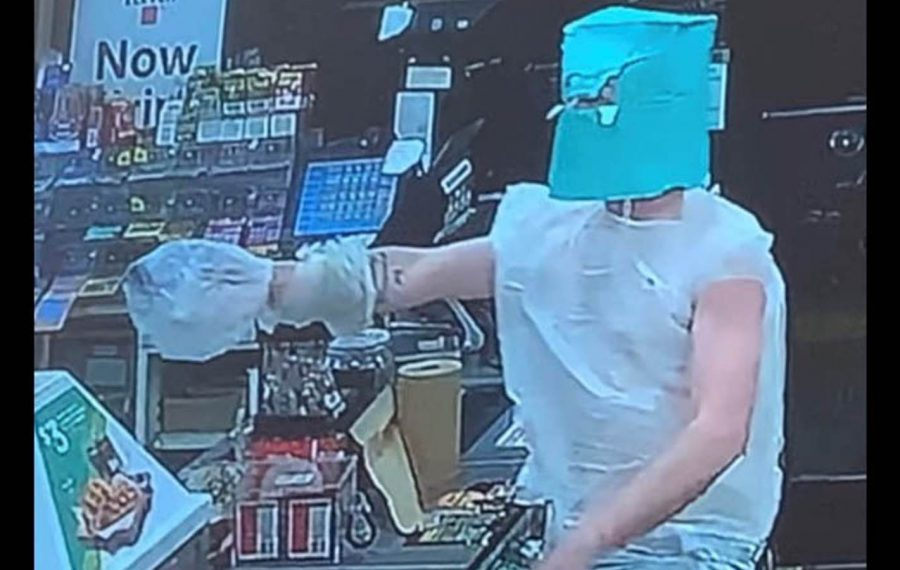 Police are looking for a man who wore plastic bags while robbing as many as three stores in Niagara Falls during a 13-hour crime spree Monday. (Courtesy of the Niagara Falls Police Department)