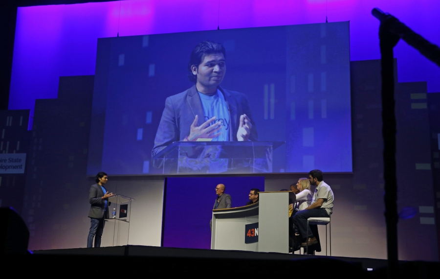Ravi Sahu, left, presents his award-winning pitch to the judges at the 43North finals. (Robert Kirkham/Buffalo News)