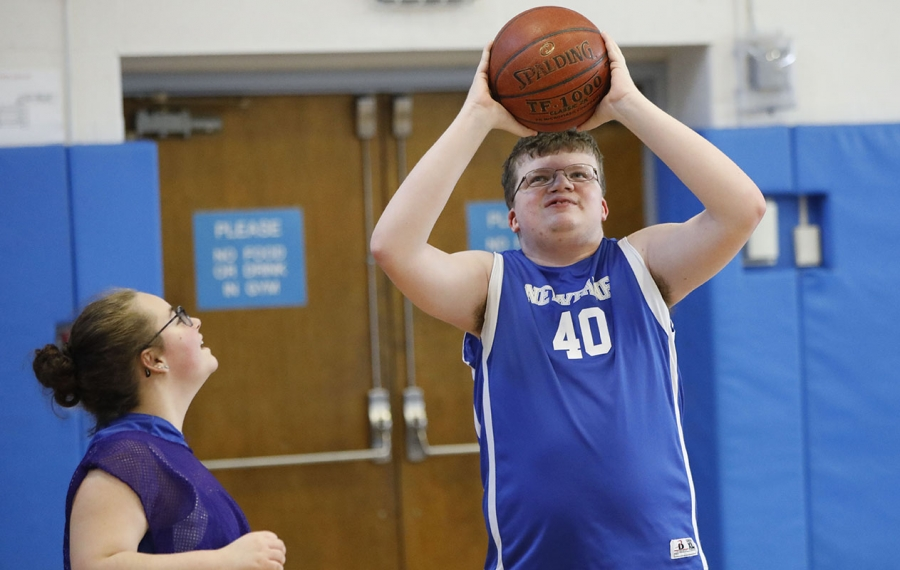 Matt Murray puts up a shot during a scrimmage last season with the Newfane High School unified basketball team. Unless a change is made in eligibility rules, Murray's career is over almost two years before he finishes high school. (Derek Gee/News file photo)