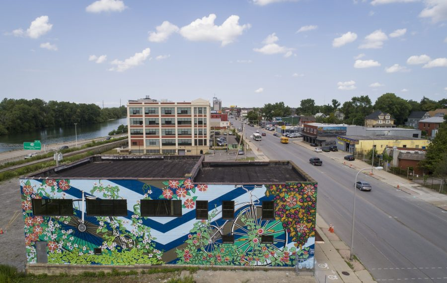 """1800s Bikes in Vines,"" a new mural by Nicole Cherry on 1330 Niagara St., is part of an explosion of murals in Buffalo over the past several years. (Derek Gee/Buffalo News)"
