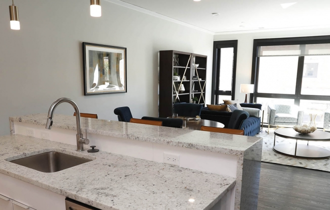 The granite kitchen counter and white gloss laminate cupboards at Nineteen North, where apartments range from 880 to 1,700 square feet. (Sharon Cantillon/Buffalo News)