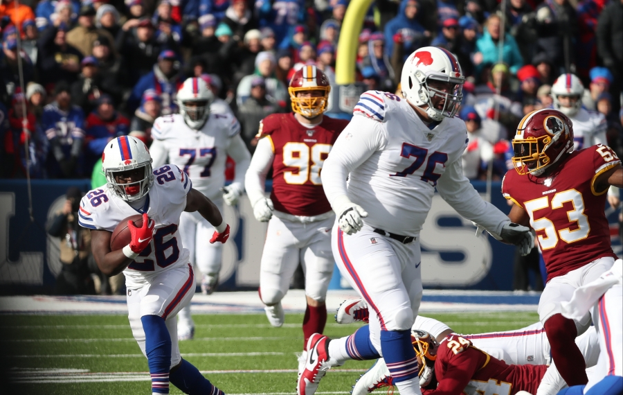 Devin Singletary (26) rushes against the Washington Redskins. (James P. McCoy/Buffalo News)