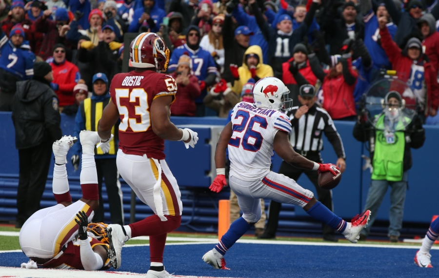 Devin Singletary rushes for a touchdown past Redskins linebacker Jon Bostic (53) in the fourth quarter. (James P. McCoy/Buffalo News)